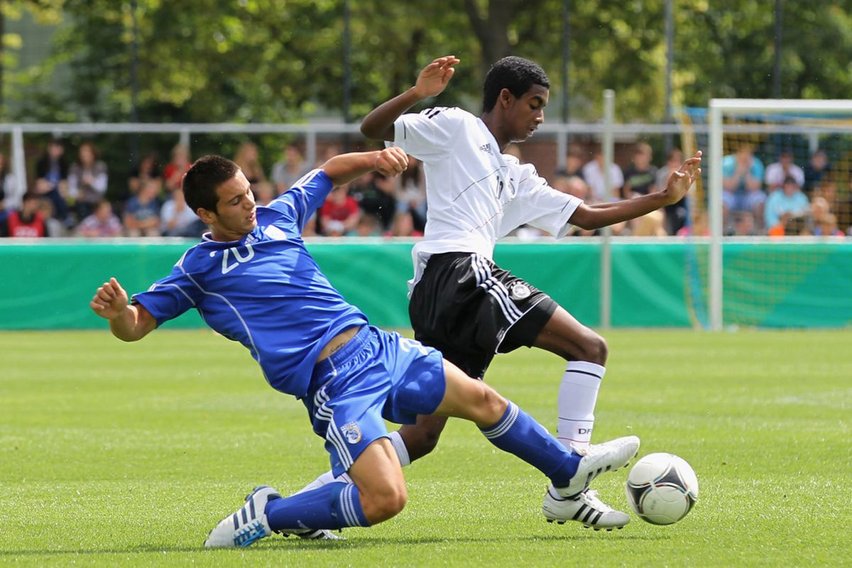 the man (kid?) himself, playing for Germany. DON'T DO IT GEDION, WE HAVE AMERICAN COOKIES