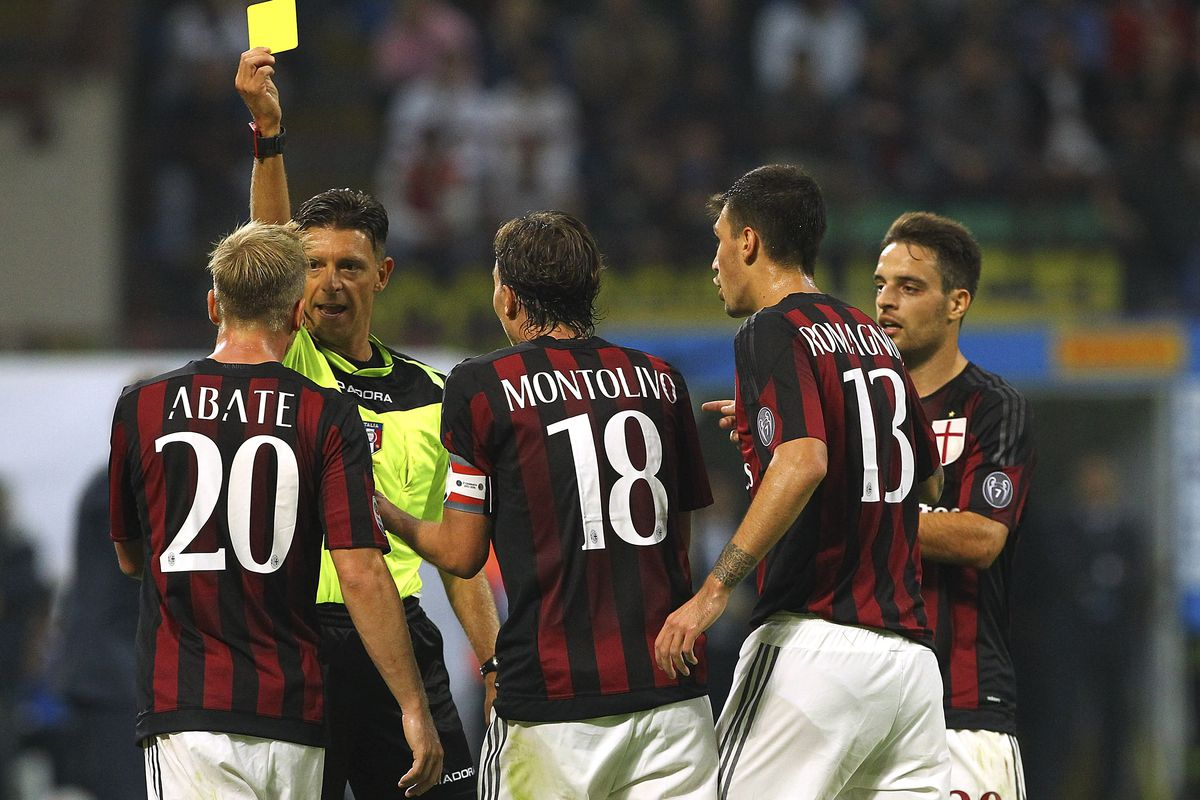 Ignazio Abate receives a yellow card during the Derby Della Madonnina Sunday.