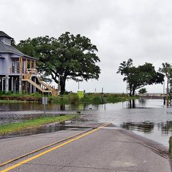 Storm surge and heavy rains associated with Tropical Storm Cindy cause flooding in many areas of the Mississippi coast, including this area at the foot of Washington Avenue just off Front Beach in Ocean Springs, Miss., Wednesday, June 21, 2017.