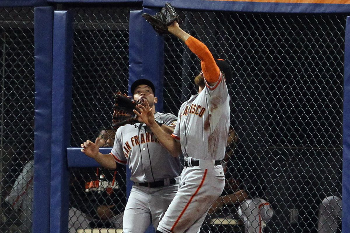 Pictured: Hunter Pence and Juan Perez cover left field for Michael Morse.