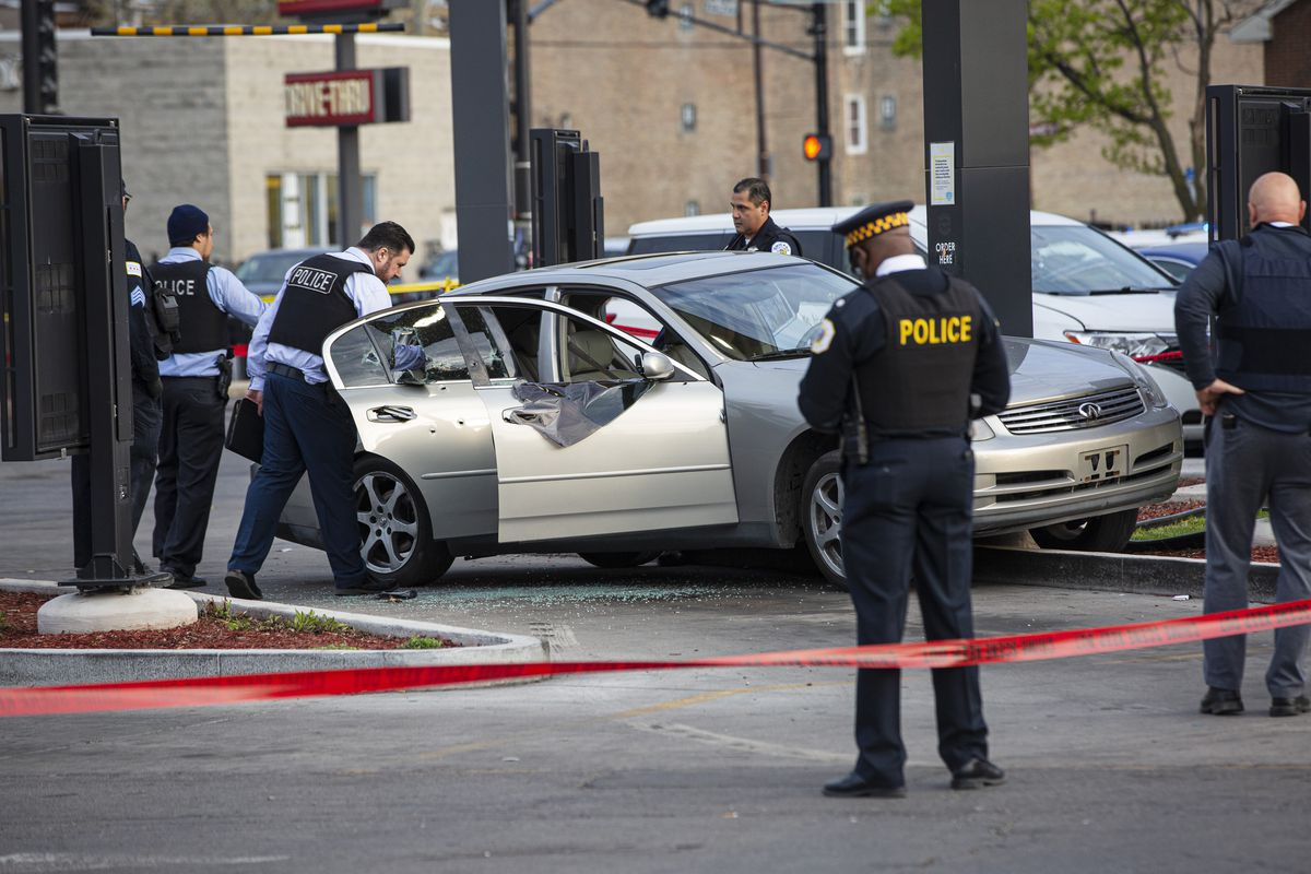 Chicago Police on Sunday evening investigate a shooting scene where a 7-year-old girl was shot and killed, and her father was seriously wounded while in their car at a McDonald's in the Homan Square neighborhood.