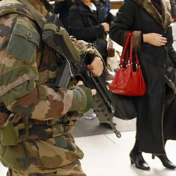 French soldiers patrol in Gare De Lyon railway station in Paris, France, Tuesday, March 22, 2016. Authorities are tightening security at airports and on the streets of European cities after attacks on the Brussels airport and subways system that killed at least one person and injured many others.
