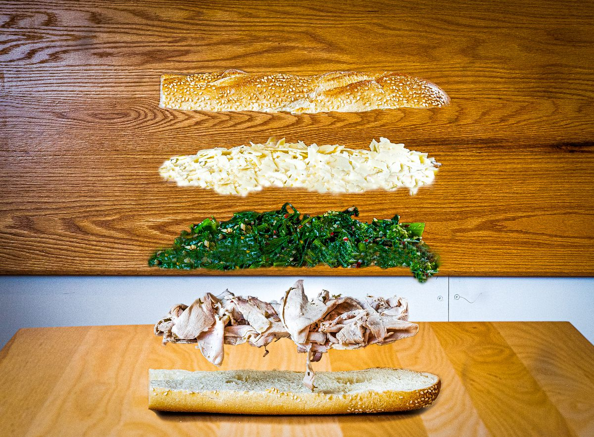 A photo illustration showing separated elements of Grazie Grazie's Russoniello sandwich (bread, aged Parmesan, broccoli rabe, shaved pork) floating in the air.