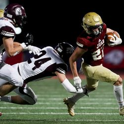 Juab's Dawson Olsen avoids the tackle from Morgan's Isaac Rees in the 3A football championship game at Dixie State University in St. George on Saturday, Nov. 14, 2020.