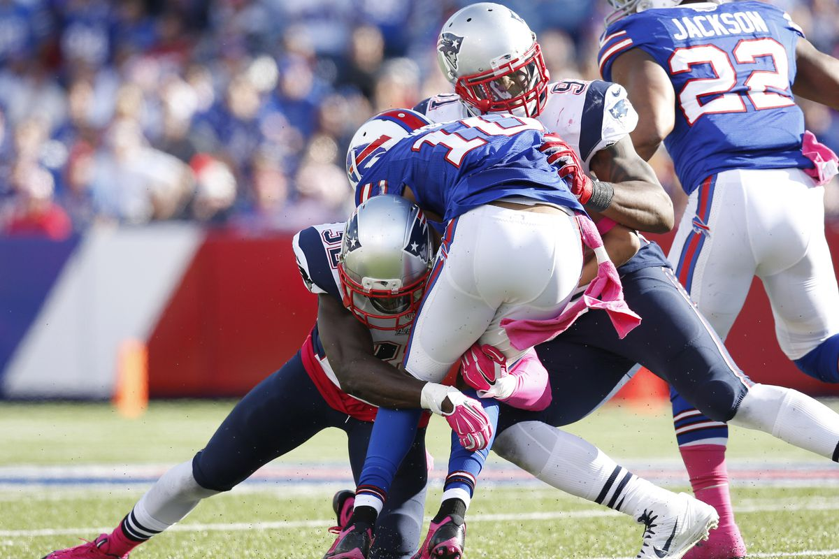 Devin McCourty and Jamie Collins team up on a tackle