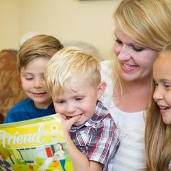 A mother reads the Friend magazine with her children. Twila shares a story of how the Friend preserved the family history of her sister-in-law.