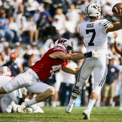 Brigham Young Cougars quarterback Beau Hoge (7) gets a pass off ahead of a tackle from Wisconsin Badgers linebacker Ryan Connelly (43) during the game at LaVell Edwards Stadium in Provo on Saturday, Sept. 16, 2017.