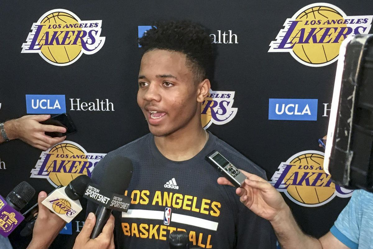 Markelle Fultz, center, speaks with reporters after his private workout with the Los Angeles Lakers at NBA basketball team's training complex Thursday, June 15, 2017, in El Segundo, Calif. The University of Washington guard could be the No. 1 pick in the