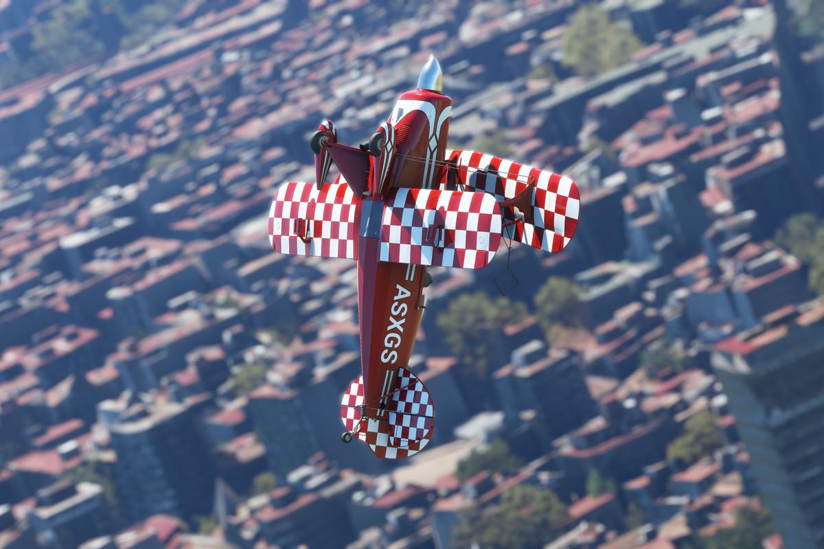 An aerobatic plane in flight.