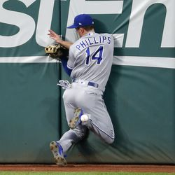 Brett Phillips crashes into the wall trying to catch a ball hit by Jose Ramirez.