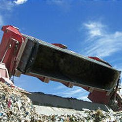 """At the commercial landfill in East Carbon, the """"rotary unloader"""" empties a train car."""