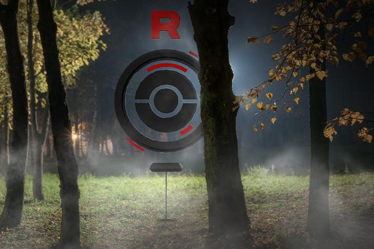 A shadowy Pokéstop sits in a forest, taken over by Team Rocket grunts.