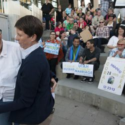 Cody Partridge dances with her wife, Laurie Wood, left, during a same sex marriage celebration at Library Square in Salt Lake City, Monday, Oct. 6, 2014.