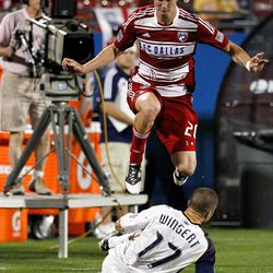 FRISCO, TX - APRIL 25:  Brek Shea #20 of the FC Dallas hurdles Chris Wingert #17 of the Real Salt Lake after passing the ball at FC Dallas Stadium on April 25, 2012 in Frisco, Texas.  (Photo by Tom Pennington/Getty Images)