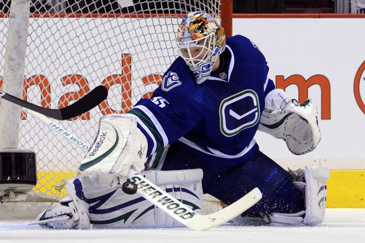 VANCOUVER CANADA - JANUARY 7: Goalie Cory Schneider #35 of the Vancouver Canucks makes a pad save against the Edmonton Oilers during the second period at Rogers Arena January 7 2011 in Vancouver BC Canada.  (Photo by Rich Lam/Getty Images)