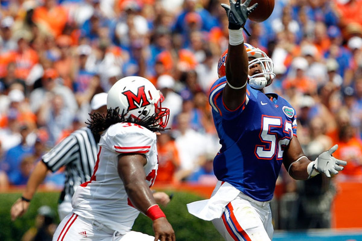 GAINESVILLE FL - SEPTEMBER 04:  Jonathan Bostic #52 of the Florida Gators attempts an interception against the Miami University RedHawks at Ben Hill Griffin Stadium on September 4 2010 in Gainesville Florida.  (Photo by Sam Greenwood/Getty Images)