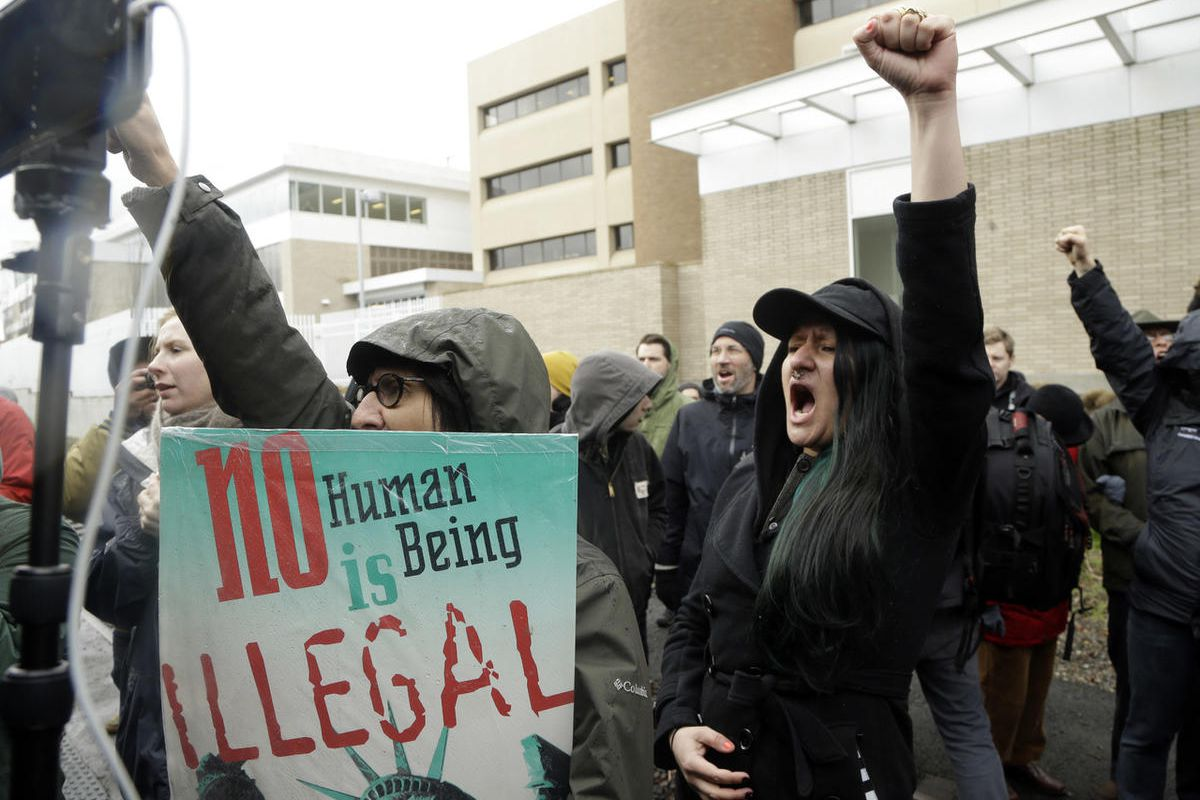 FILE--In this Feb. 27, 2017, file photo, protestors chant during a rally in Portland, Ore.outside the Immigration and Customs Enforcement building. Oregon's Legislature has taken a step closer to defying a federal government crackdown on illegal immigrati