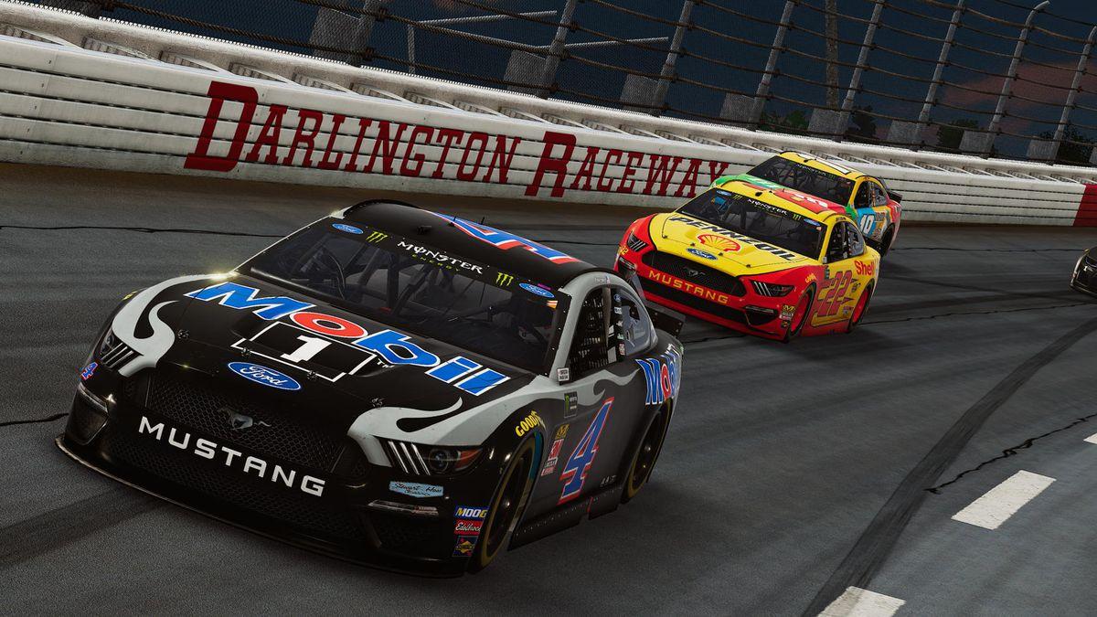 Screenshot of Kevin Harvick and Joey Logano's cars in a turn at Darlington Raceway in NASCAR Heat 4