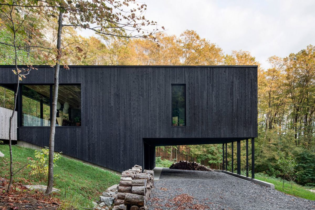 Black Clad Modern Home Creates A Hillside Aerie In Quebec