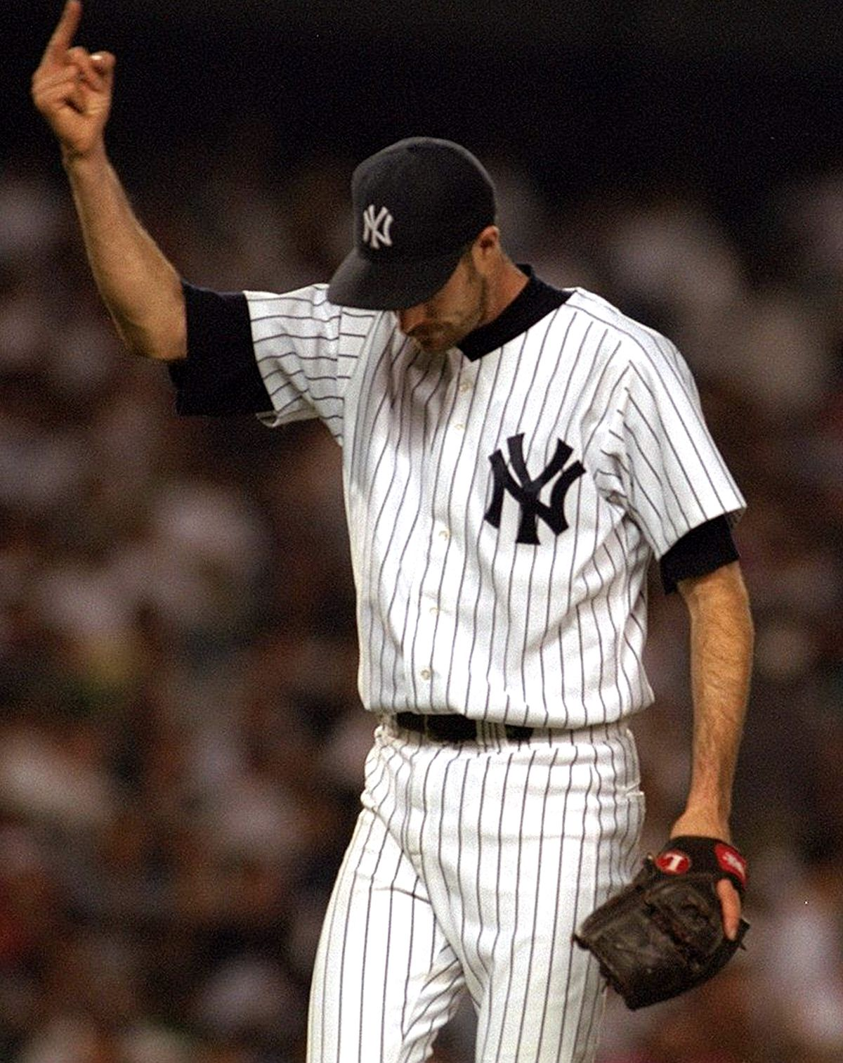 New York Yankees pitcher Jack McDowell gives the finger at Yankees Stadium.