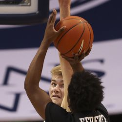 Brigham Young Cougars forward Matt Haarms (3) guards Portland Pilots guard Quincy Ferebee (4) at the Marriott Center in Provo on Thursday, Jan. 21, 2021.
