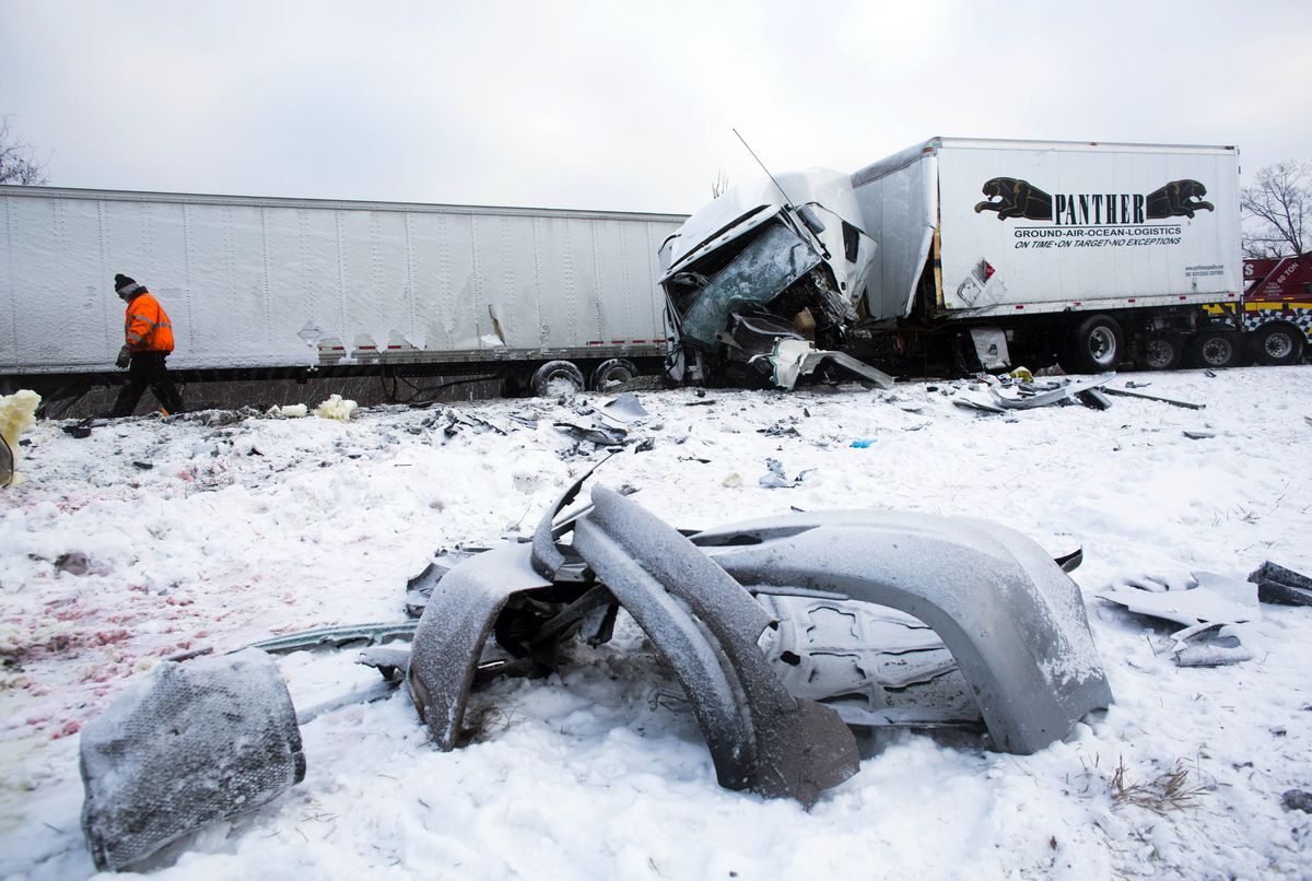 <small><strong>Road crews work to clear wrecked vehicles and debris along Interstate 94, Saturday, Jan. 10, 0215, the day after a series of crashes closed the highway between mile markers 88 and 92 in eastern Kalamazoo County. | Christian Randolph / AP</s