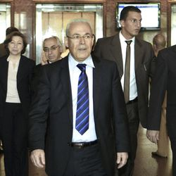 """Leader of the opposition of the Syrian National Council, Burhan Ghalioun, center, and other unidentified members leave a meeting with Egyptian Foreign Minister Mohamed Kamel Amr, unseen, in Cairo, Egypt, Monday, April 23, 2012. Minister Mohammed Amr stressed to the opposition that they must unify their ranks under one group with one vision presented to the world about the future of Syria. """"This in itself will send a reassuring message to all regional and international parties about the possibility of starting a dialogue with the opposition,"""" he said. (AP Photo/Amr Nabil)"""