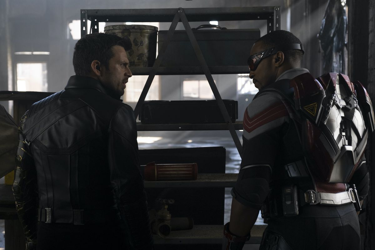 Bucky (Sebastian Stan) and Falcon (Anthony Mackie) face off over an equipment rack in Falcon and the Winter Soldier