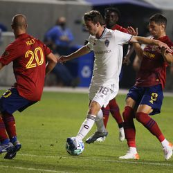 Real Salt Lake defender Erik Holt (20) and midfielder Damir Kreilach (8) attempts to stop Colorado Rapids defender Jeremy Kelly (18) during an MLS soccer game at Rio Tinto Stadium in Sandy on Saturday, Sept. 12, 2020.