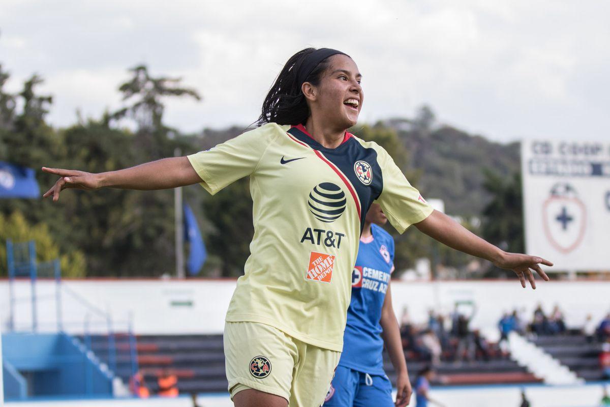 Lucero Cuevas celebrates a goal for Club América against Cruz Azul.