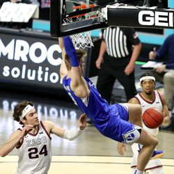 Brigham Young Cougars forward Matt Haarms (3) dunks over Gonzaga Bulldogs forward Corey Kispert (24) as BYU and Gonzaga play in the finals of the West Coast Conference tournament at the Orleans Arena in Las Vegas on Tuesday, March 9, 2021.