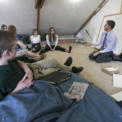Sam Martineau teaches a debate class. A group of home-schooled kids attend a debate class Friday, March 29, 2013, in Orem.
