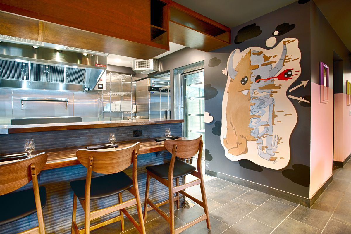 Restaurant interior centered around bar top and art