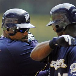 Milwaukee Brewers' Prince Fielder, right, celebrates his home run against the San Diego Paders with teammate Mike Cameron.