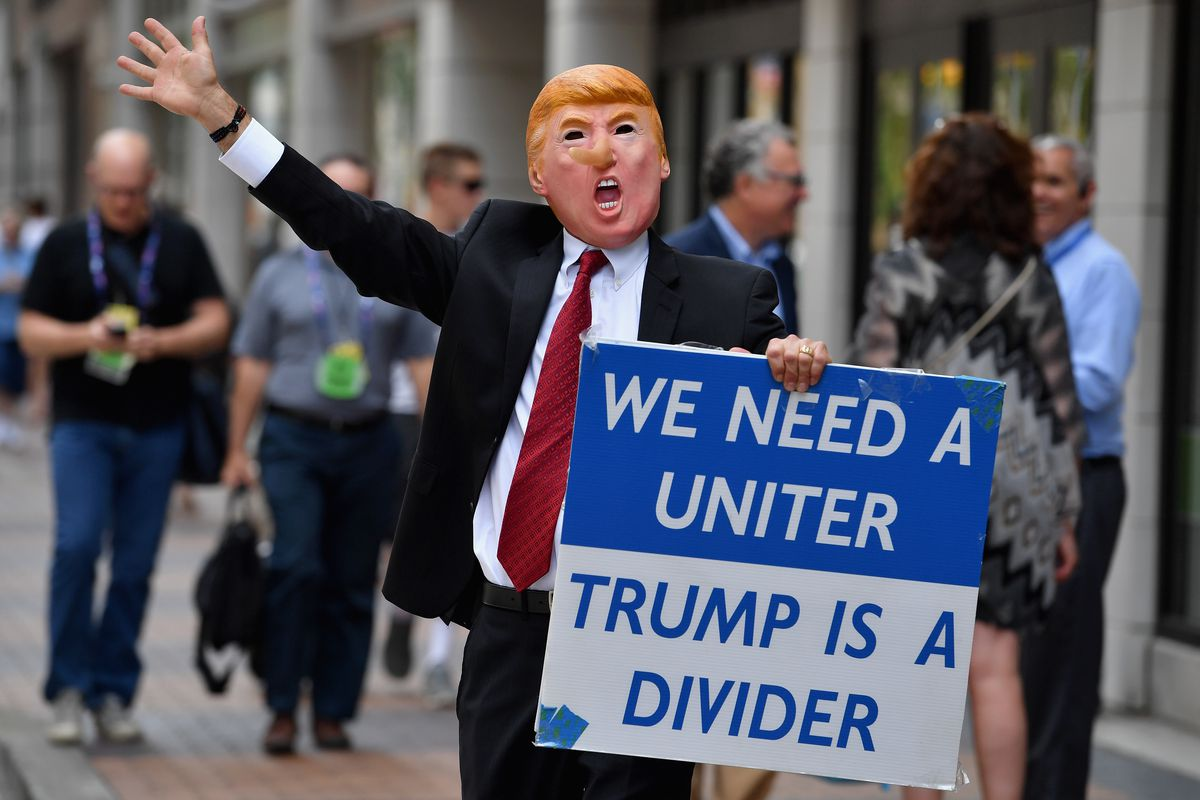 A man wearing a Donald Trump mask in downtown Cleveland on Monday.