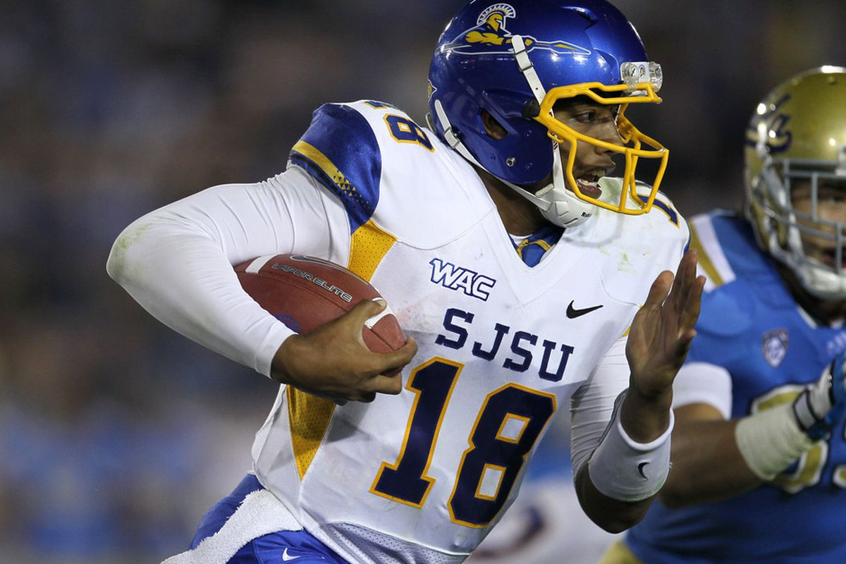 PASADENA, CA - SEPTEMBER 10:  Quarterback Dasmen Stewart #18 of the San Jose State Spartans carries the ball against the UCLA Bruins at the Rose Bowl on September 10, 2011 in Pasadena, California. UCLA won 27-17.  (Photo by Stephen Dunn/Getty Images)