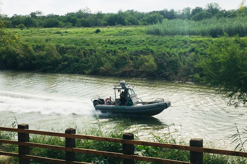 A U.S. Border Patrol boat navigates the Rio Grande near where the bodies of Salvadoran migrant Oscar Alberto Martínez Ramírez and his nearly 2-year-old daughter Valeria were found, in Matamoros, Mexico, Monday, June 24, 2019, after they drowned trying to