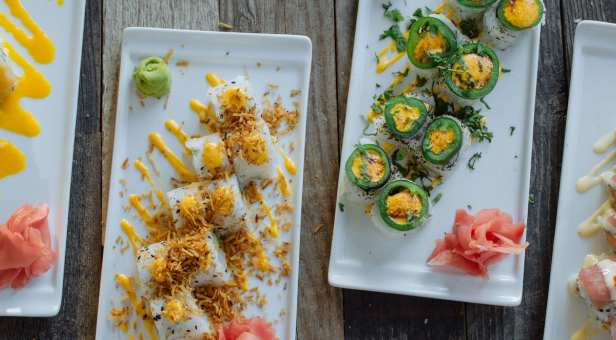 dinner plates with rolls of sushi options