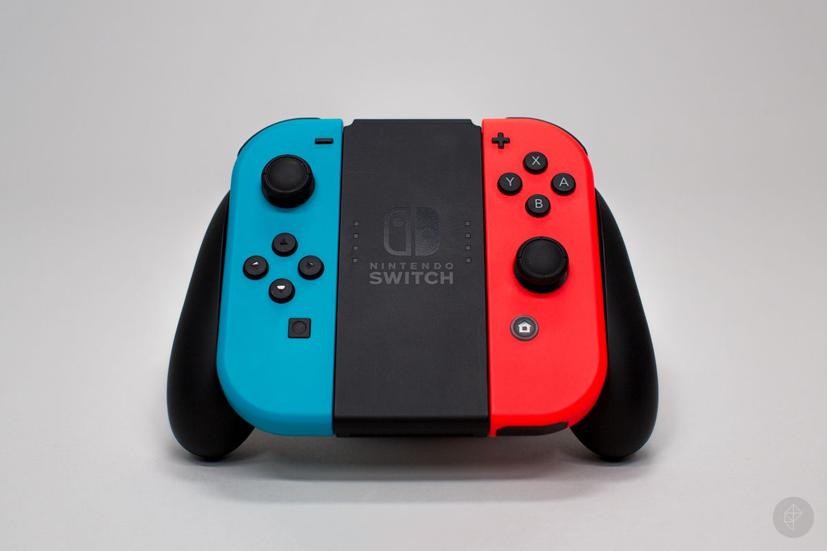 Nintendo Switch - front angle view of neon Joy-Cons in Grip