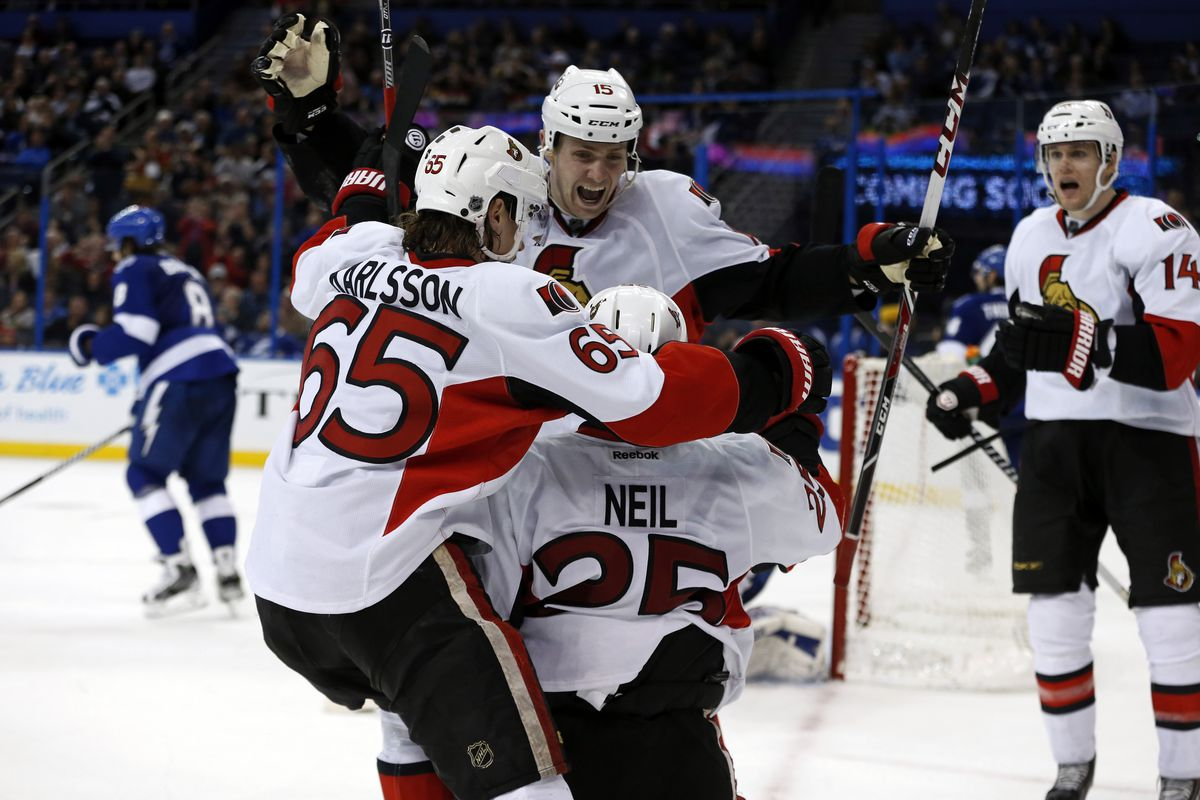 Chris Neil pulls a classic ninja move to force Karlsson and Z. Smith to bash heads.