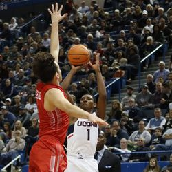 UConn's Christian Vital (1) puts up a three-pointer over a Boston University defender.