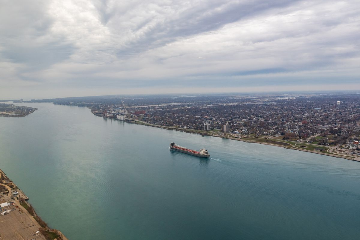 A barge moves north up the Detroit River.