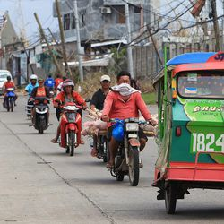Vehicles travel in Ormoc, Tuesday, Nov. 19, 2013.