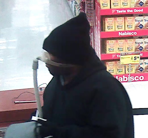 Surveillance photo of the suspect who robbed a Waukegan bank Wednesday night. | Waukegan police