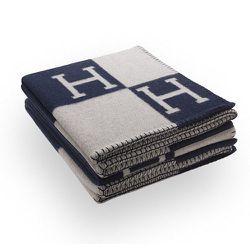 "<strong>Hermès</strong> Avalon Blanket, <a href=""http://usa.hermes.com/house/blankets-pillows/avalon-blankets/jete-de-canape-avalon.html"">$1,500</a>"