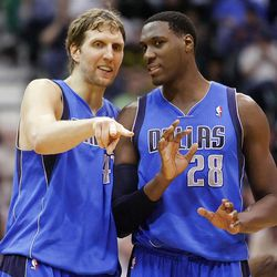 Dallas Mavericks forward Dirk Nowitzki (41) and Dallas Mavericks center Ian Mahinmi (28) talk as the Utah Jazz and  the Dallas Mavericks play Monday, April 16, 2012 in Salt Lake City.