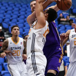 Los Angeles D-Fenders center David Foster (50) shots down Salt Lake City Stars forward JJ O'Brien (22) during the game at the Lifetime Activities Center in Taylorsville on Wednesday, Feb. 08, 2017.