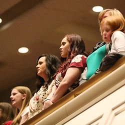Women sing a hymn during The Church of Jesus Christ of Latter-Day Saints' General Women's Session of the 187th Annual General Conference in the Conference Center in Salt Lake City on Saturday, March 25, 2017.