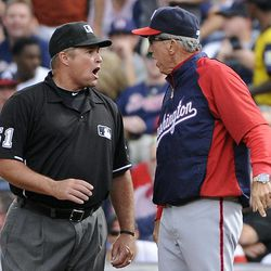 Washington Nationals manager Davey Johnson, right, argues with first base umpire Marvin Hudson, before Johnson was ejected during the sixth inning of the Nationals' baseball game with the Atlanta Braves on Saturday, Sept. 15, 2012, in Atlanta.