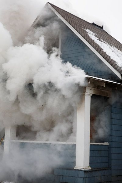 Smoke From Fire Coming Out Of House Windows